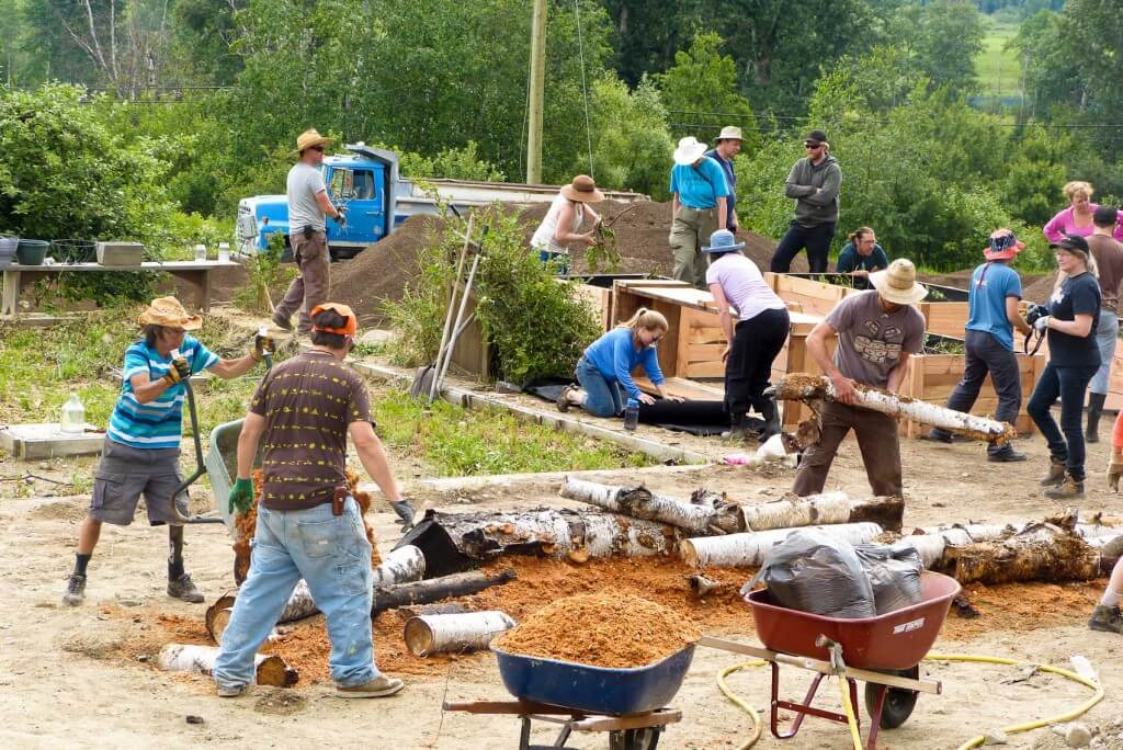 Building hugels builds community: assembling wood, chips and other materials.