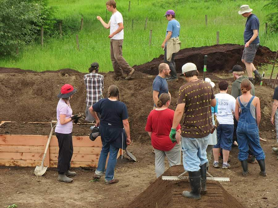 Everyone gets involved in building raised beds, hugels and highbeds.