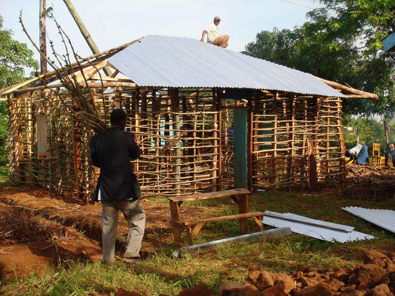 Putting the roof on the kitchen building