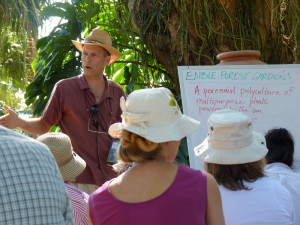 Ron Berezan teaches about edible food forests in a tropical edible food forest as the background for this 'green board' lecture.