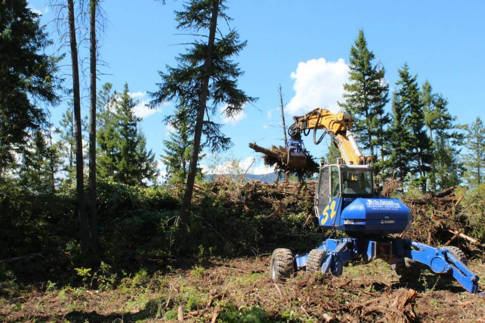 A specialized Kaiser Spider excavator makes building the massive hugelkultur look easy.