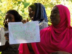 Students at the Practical Permaculture Institute of Zanzibar showcase their design projects.